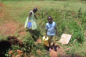 The Water Project: Mahanga Community -  Going To Fetch Water