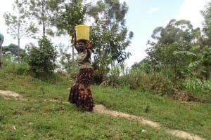 The Water Project: Murumba Community, Muyokani Spring -  Carrying Water