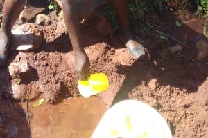 The Water Project: Wanzuma Community, Wanzuma Spring -  Fetching Water