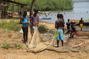 The Water Project: Rogbere Community -  Mending Nets