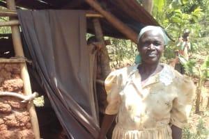 The Water Project: Visiru Community, Kitinga Spring -  Ester Aguiya By Her Latrine