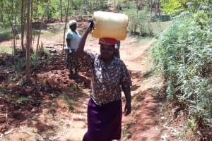 The Water Project: Wanzuma Community, Wanzuma Spring -  Catherine Lumadede Balancing Water On Her Head
