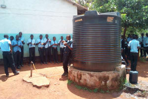 The Water Project: Friends Secondary School Shamakhokho -  Students Eat Around One Of The Tanks