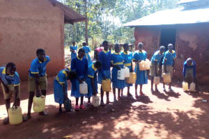 The Water Project: Ematsuli Primary School -  Students With Water From Home