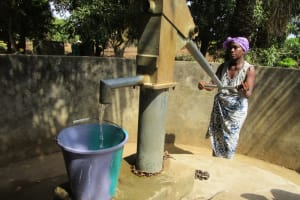 The Water Project: Royema Community A -  Fetching Water From The Seasonal Well