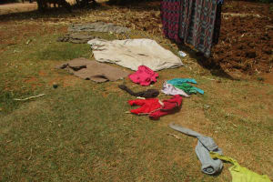 The Water Project: Lwangele Primary School -  Clothes Drying On The Ground