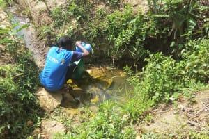 The Water Project: Shikoti Community -  Fetching Water