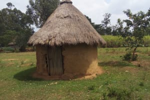 The Water Project: Shikoti Community, Amboka Spring -  Traditional Hut For Head Of Household