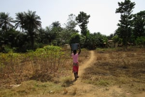 The Water Project: Kitonki Community, War Wounded Camp -  Carrying Water