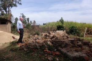 The Water Project: Emulakha Primary School -  Showing Us Recently Demolished Latrines