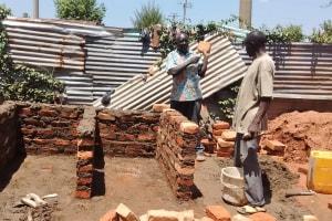 The Water Project: Matende Girls High School -  Artisan Explaining Construction Process