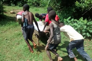 The Water Project: Eluhobe Community, Amadi Spring -  Community Children Work As A Team To Get Materials At The Spring