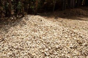 The Water Project: Bukhakunga Community, Indiatsi Omukitsa Spring -  Some Men Break Up Rocks To Earn Money