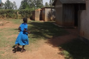 The Water Project: Bumini Primary School -  Girl Rushes To Use Latrines