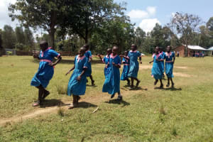 The Water Project: Maganyi Primary School -  Girls Rush To Use Latrines