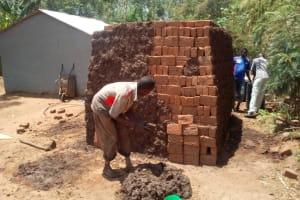 The Water Project: Handidi Community, Kadasia Spring -  Baking Bricks