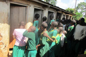 The Water Project: Mukhombe Primary School -  Girls Line Up For Latrines