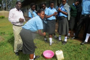 The Water Project: Bumuyange Secondary School -  Health Club President Demonstrates How To Wash Hands