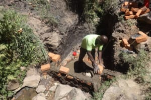 The Water Project: Shitungu Community, Hessein Spring -  Construction