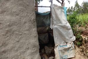 The Water Project: Shitungu Community B, Charles Amala Spring -  Bathing Room