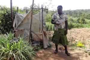 The Water Project: Shikoti Community, Amboka Spring -  Mrs Egesa Beside Her Latrine