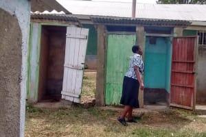 The Water Project: Eshisuru Primary School -  Teacher Showing Us The Latrines