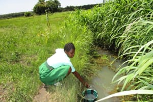 The Water Project: Kulufai Rashideen Secondary School -  Student Fetching Water