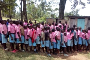 The Water Project: Muhudu Primary School -  Boys Waiting For Latrines