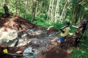 The Water Project: Kidinye Community, Wamwaka Spring -  Carrying Materials