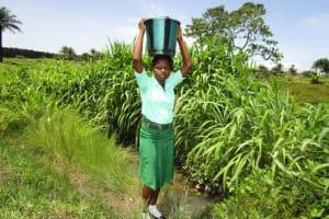 The Water Project: Kulufai Rashideen Secondary School -  Carrying Water