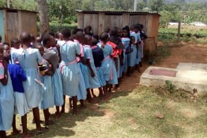 The Water Project: Muhudu Primary School -  Girls Waiting For Latrines