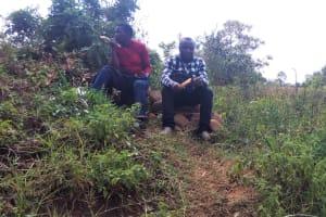 The Water Project: Emarembwa Community, Nyangweso Spring -  Staff Enjoying Sugarcane After Training