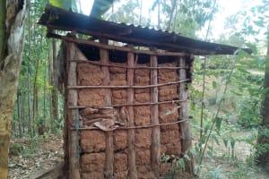 The Water Project: Handidi Community, Kadasia Spring -  Mud Latrine
