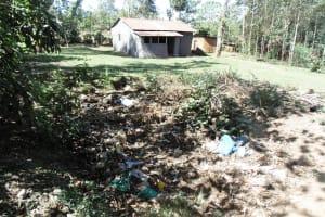 The Water Project: Shiamboko Community, Oluchinji Spring -  Garbage Site