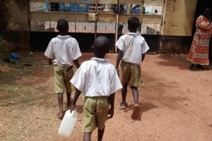 The Water Project: Esibuye Primary School -  Students Carrying Water To School