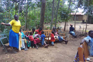 The Water Project: Emarembwa Community, Nyangweso Spring -  Community Member Talks During Training