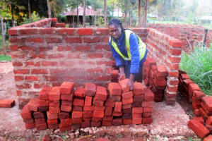 The Water Project: ADC Chanda Primary School -  Staff Jacqueline Shigali Checks Quality Of Materials