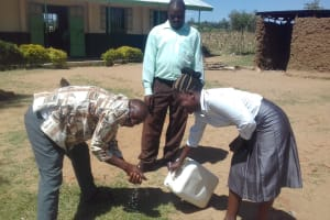 The Water Project: Emusoma Primary School -  Staff Demonstrates Hand Washing