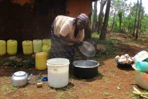 The Water Project: Esibuye Primary School -  Cook Washing Utensils