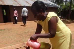 The Water Project: Emukangu Primary School, Butere -  Teacher Demonstrates Hand Washing