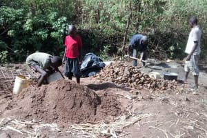 The Water Project: Emarembwa Community, Nyangweso Spring -  Mixing Concrete