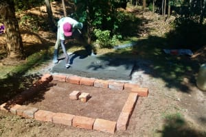 The Water Project: Bumavi Community, Shoso Mwoga Spring -  Sanitation Platform Construction