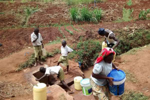 The Water Project: Esibuye Primary School -  Students Fetch Water At Community Spring