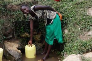 The Water Project: Shitungu Community B, Charles Amala Spring -  Miriam Fetches Water At Amala Spring