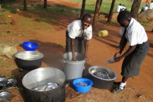 The Water Project: Matsigulu Friends Secondary School -  Students Washing Utensils With Clean Water
