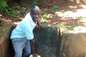 The Water Project: Eluhobe Community, Amadi Spring -  Fetching Clean Water