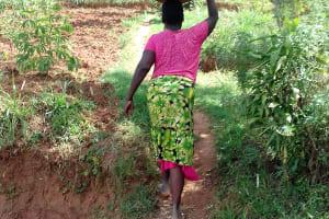 The Water Project: Igogwa Community -  Jane Balancing A Big Basin Full Of Water On Her Head