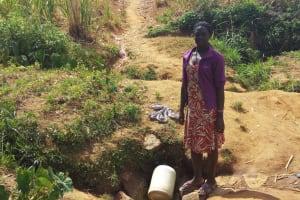 The Water Project: Futsi Fuvili Community, Futsi Fuvili Spring -  Lady Waits For Her Jerrycan To Fill