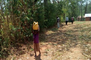 The Water Project: Handidi Community, Kadasia Spring -  Child Carries Water On Head