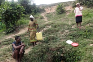 The Water Project: Shitungu Community B, Charles Amala Spring -  Women Waiting To Fetch Water